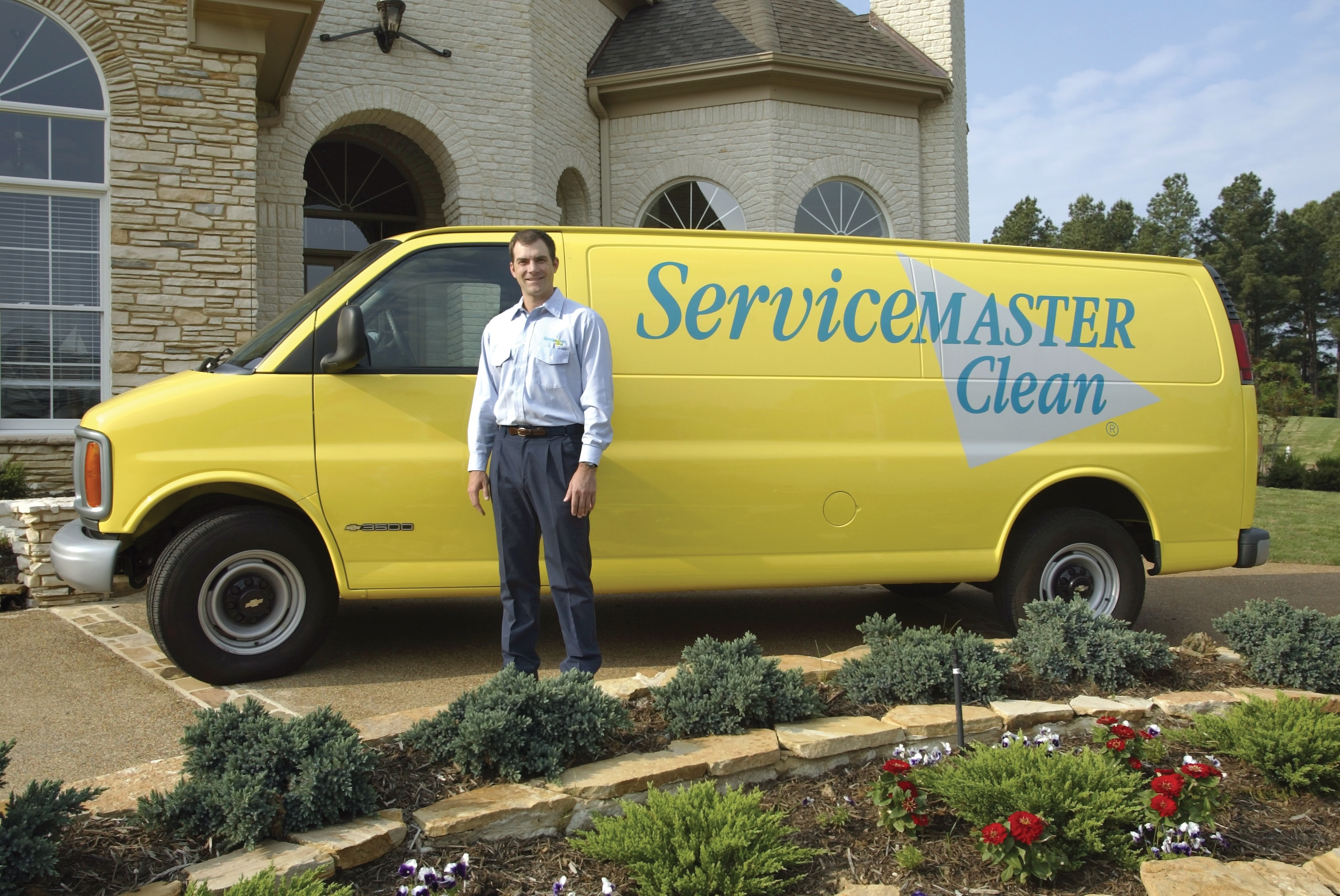ServiceMaster Employee in front of home